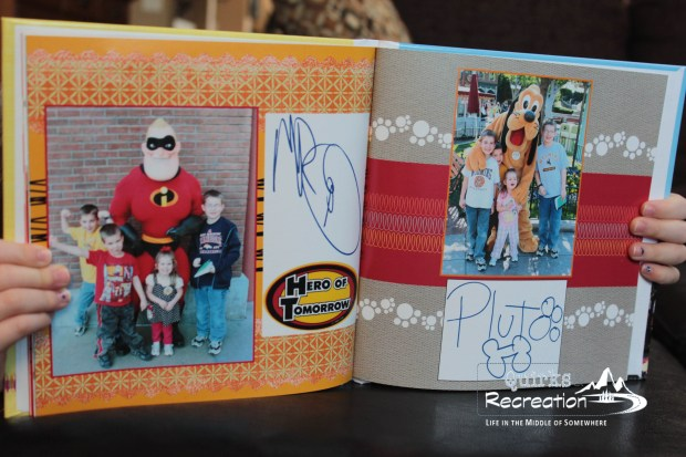Disney character autograph book inside pages showing Pluto and Mr. Incredible