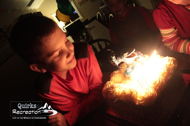 Middle son getting ready to blow out birthday candles