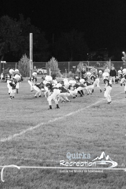 Sixth grade football scrimmage offense/defense on the line