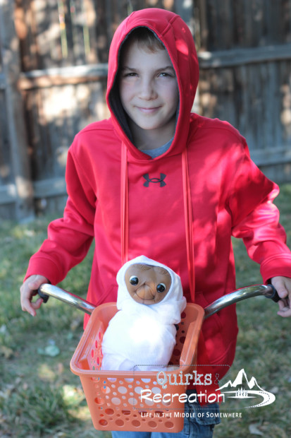 Boy dressed as Elliott from E.T. for Halloween costume
