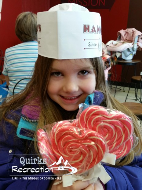 Girl holding heart-shaped lollipops made at Hammond's