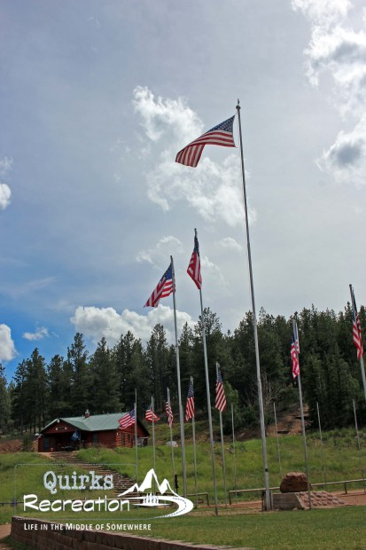 Line of American flags at Camp Alexander BSA
