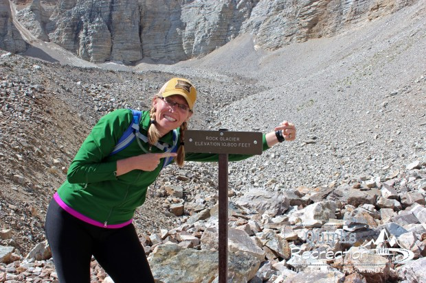 Woman posing with sign at Rock Glacier in Great Basin National Park