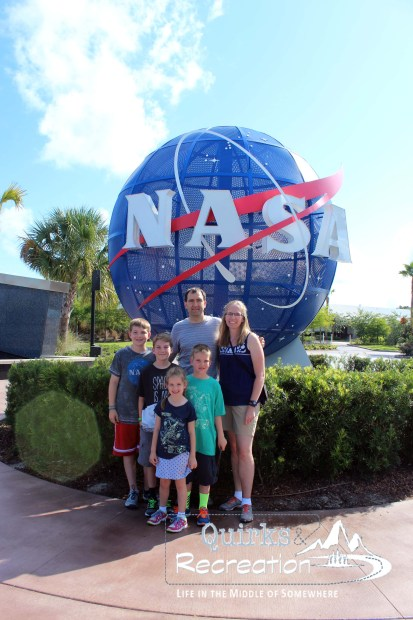 family with NASA sign at Kennedy Space Center