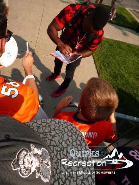 Denver Bronco Kapri Bibbs signing autographs