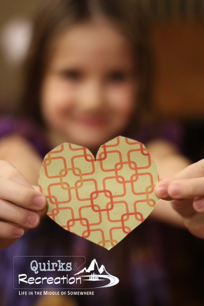 girl holding paper heart
