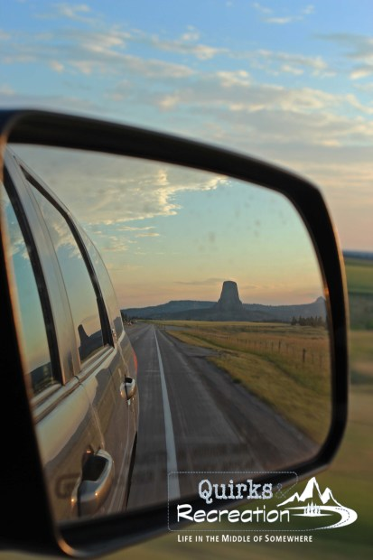 Leaving Devils Tower National Monument as seen from a vehicle side mirror