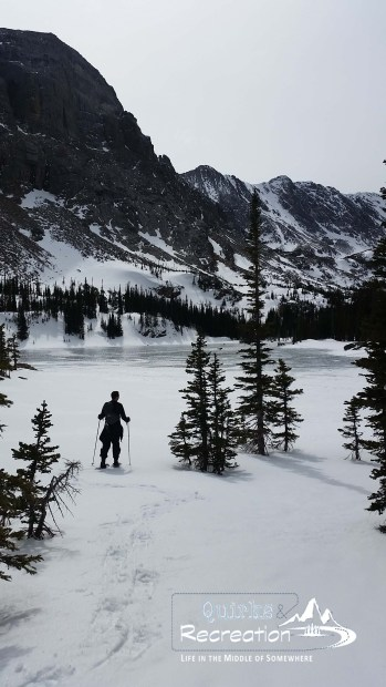 Man snowshoeing to The Loch in Rocky Mountain National Park