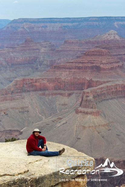 man sitting on South Rim of Grand Canyon