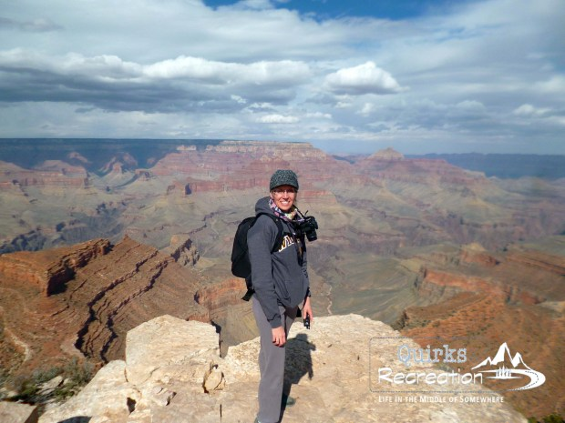 woman standing on South Rim of Grand Canyon