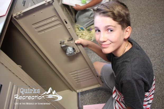 boy opening school locker
