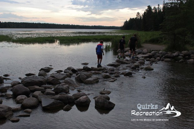 boys walking across the headwaters of the Mississippi River