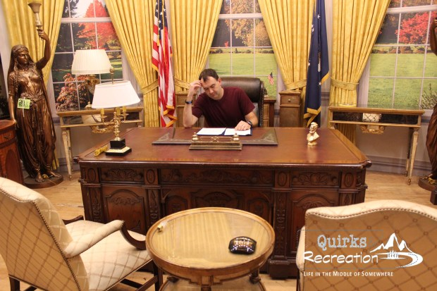 man sitting at president's desk from West Wing