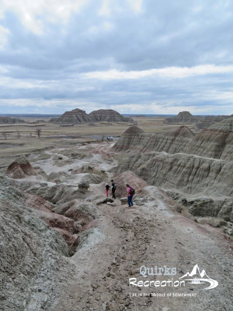 Hikers walking down Saddle Pass in Badlands National Park
