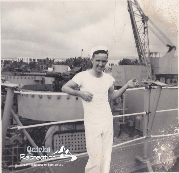 man standing on a U.S. Naval ship in the 1950s