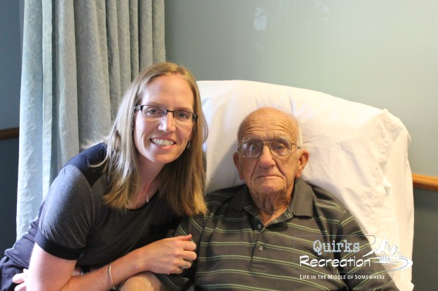grandpa and grand daughter posing