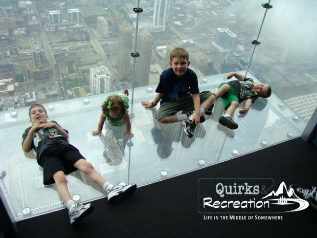 children sitting on the Ledge at Willis Tower Chicago