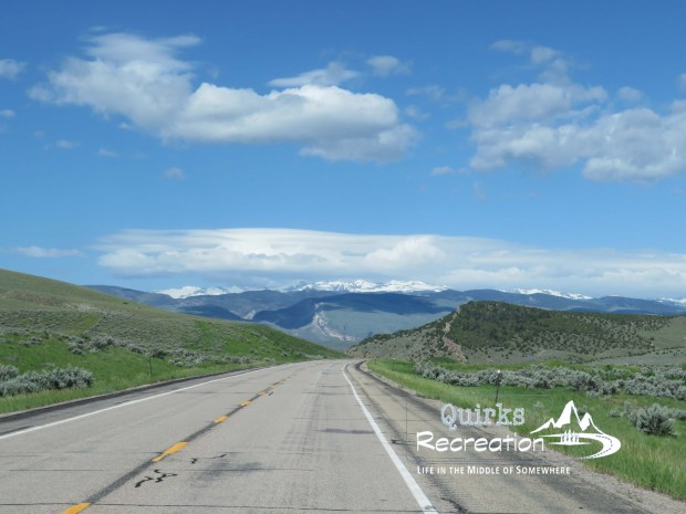 open highway looking at mountains in Wyoming