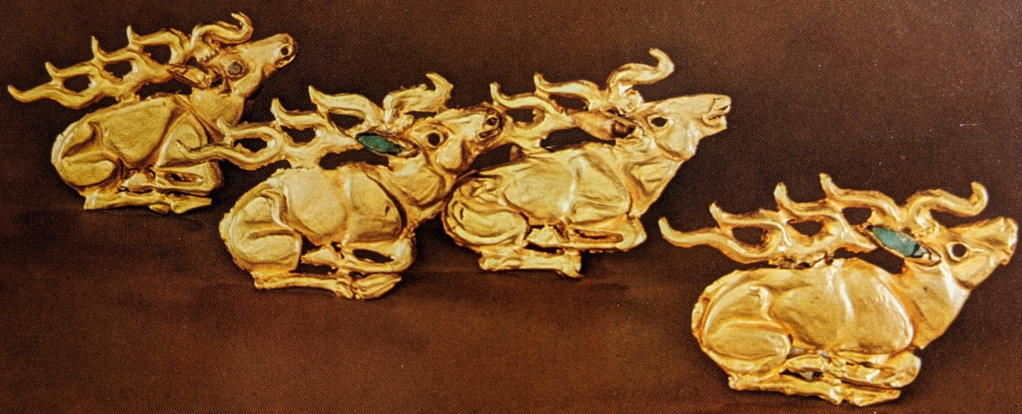 Gold stag plaques with turquoise inlay