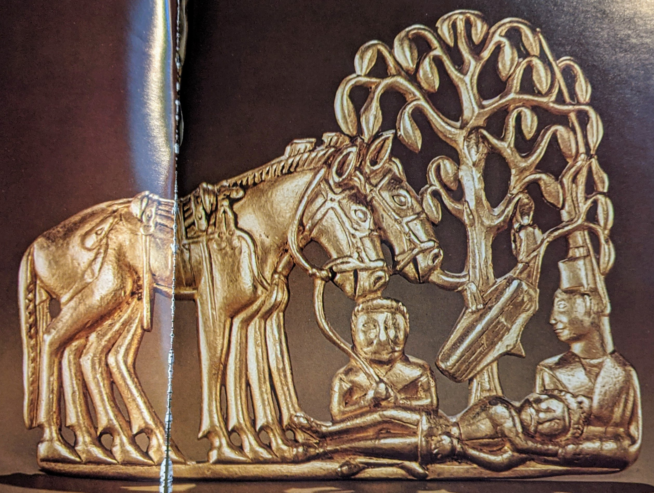 People under horses and tree gold plaque