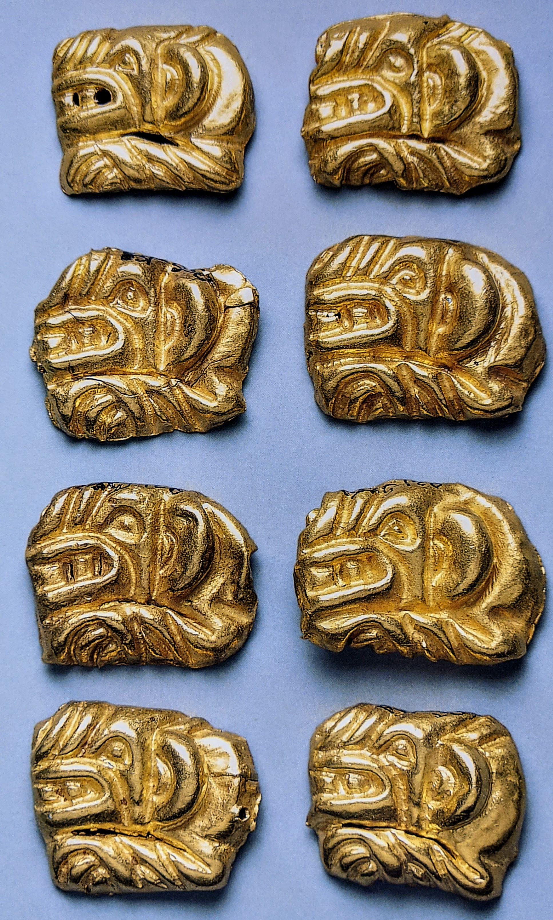 Tiger shaped gold plaques