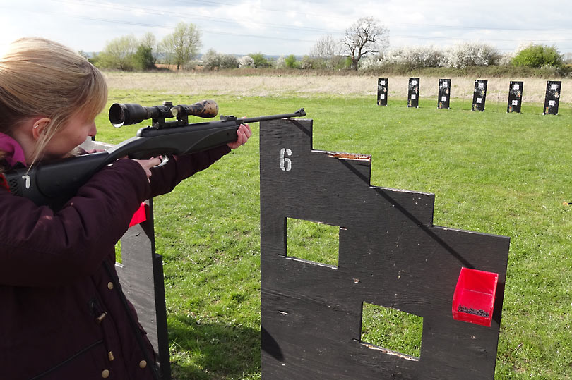 Shooting a sniper rifle at Spy Games
