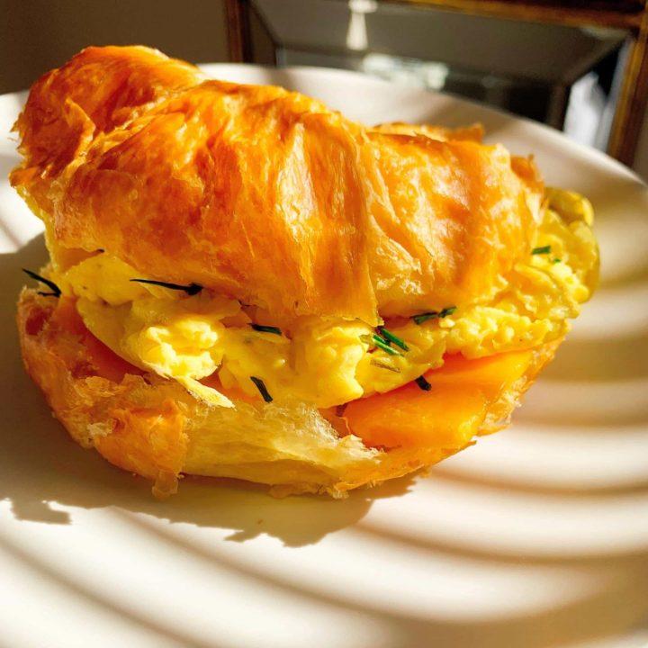 White Truffle Egg & Cheddar Croissant Sandwich 1800px