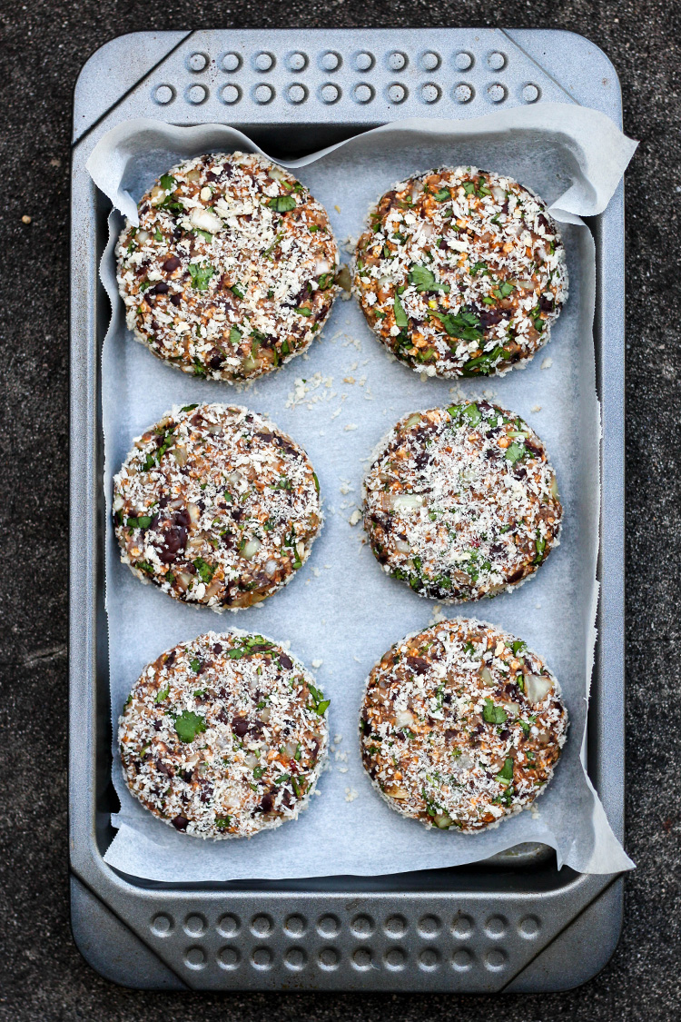 Black bean burgers, crumbed and ready to cook.