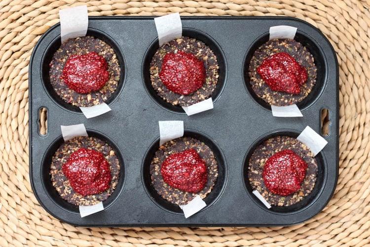 Chocolate and raspberry cheesecake base with chia jam.
