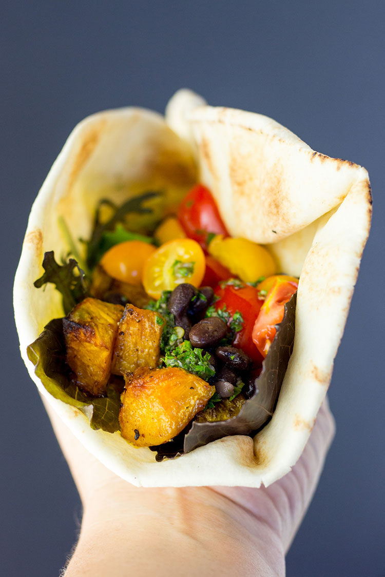 Black bean and buttercup pumpkin (squash) wraps with chimichurri sauce.
