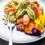 Vegan barley risotto with maple roasted carrots and kale pesto.