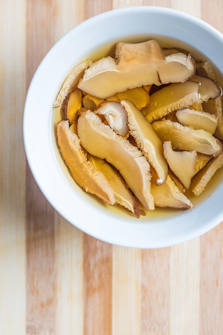 Dried shiitake mushrooms, reconstituting in boiled water.