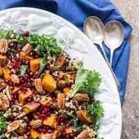 Sweet potato salad with pomegranate, pecans and barley (vegan).