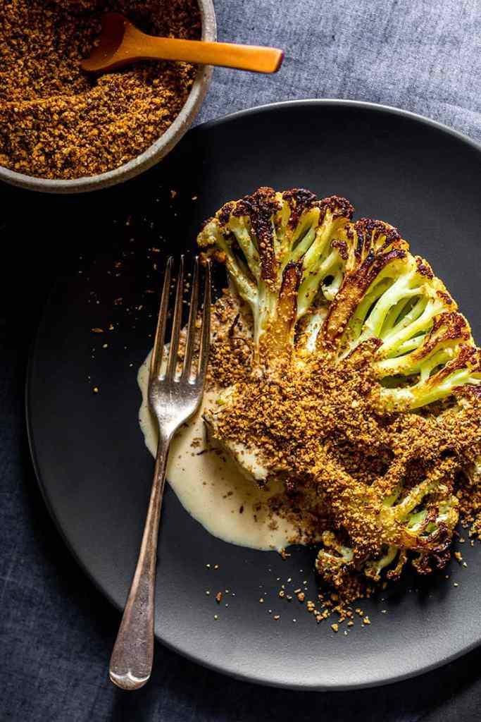 Cauliflower steak with orange tahini dressing and dukkah (vegan and gluten free).