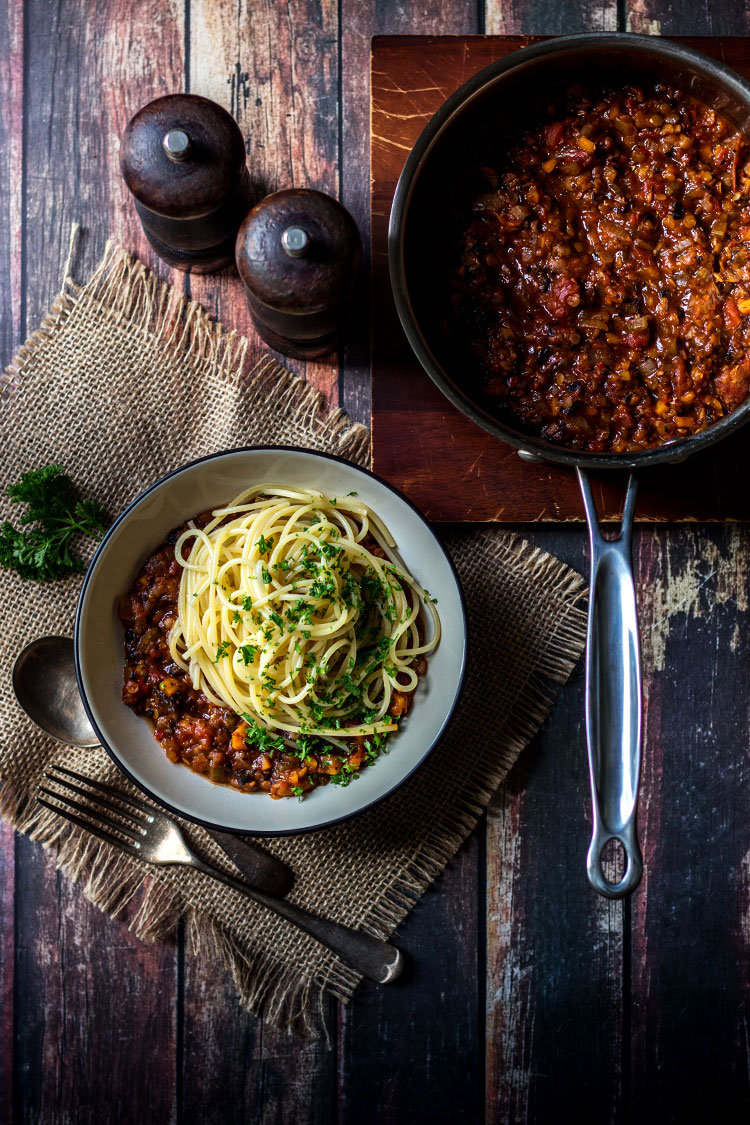 Overhead photograph of mushroom and lentil vegan spaghetti bolognese, served in a bowl (vegan and gluten free).