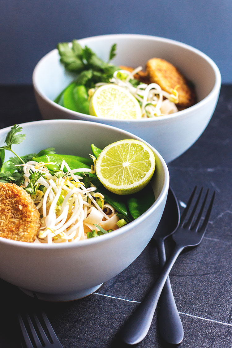 Thai curry noodle soup with chilli and lime cakes (vegan).
