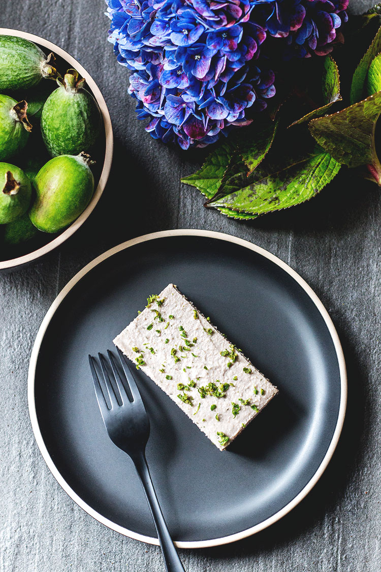Feijoa and mint vegan cheesecake, pictured with a blue hydrangea from the garden.