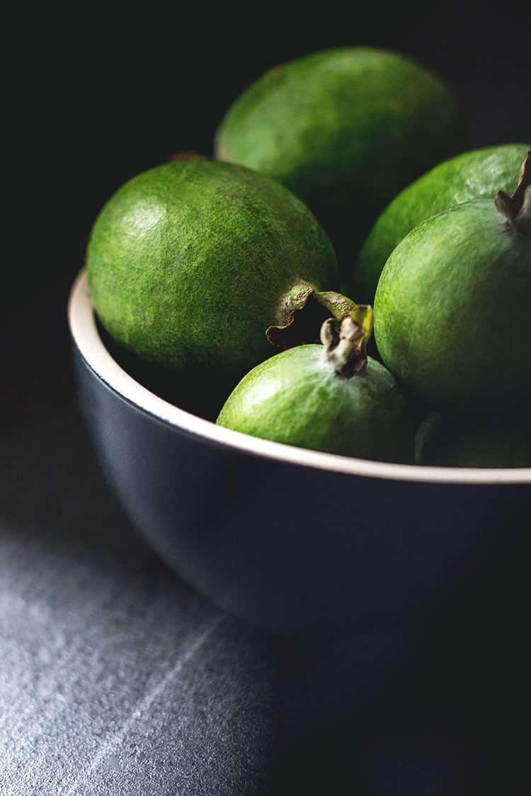 A bowl of feijoas.