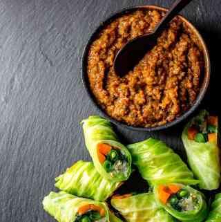 Gado gado rolls with peanut sauce.