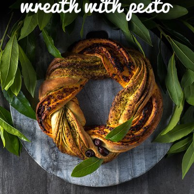 This festive Christmas bread wreath with red and green pestos is satisfying to make and a beautiful addition to any holiday table. Vegan.