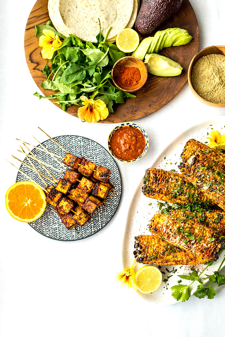 Orange chipotle tofu skewers, served with soft tacos, avocado and grilled Mexican sweet corn.