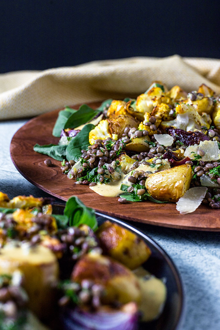 Potato, cauliflower and lentil salad with curry tahini dressing.