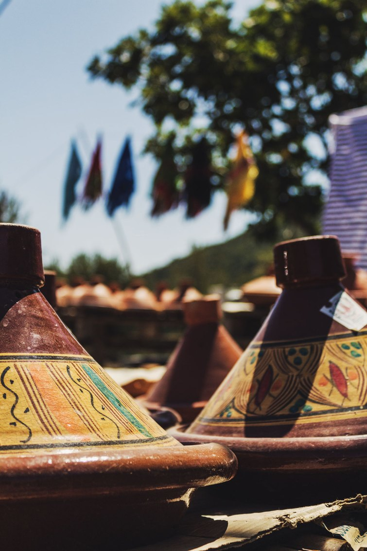 Moroccan tagines for sale at a market.