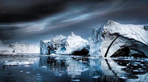 Iceburgs on dark water.