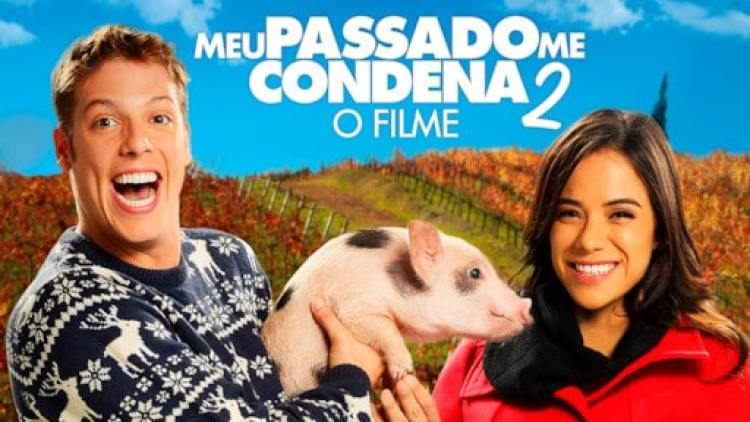 capa do filme meu passado me condena 2 - atores principais segurando um porquinho na mão