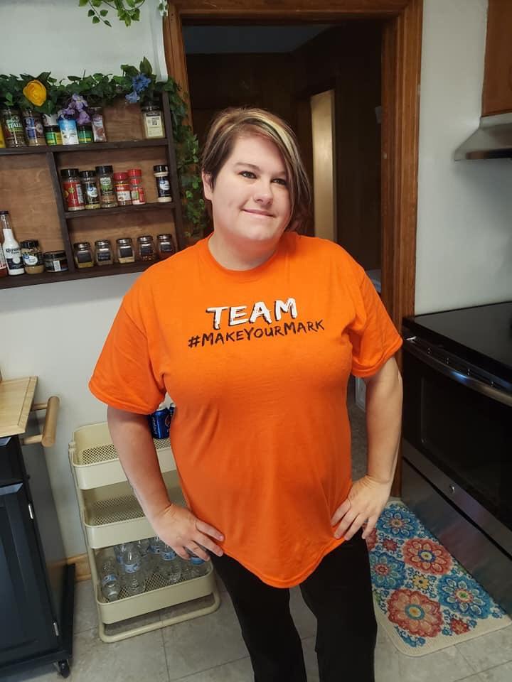 Carla Morton models supportive shirt.