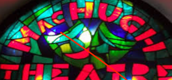 This is a picture of the stained glass window at MacHugh Theatre