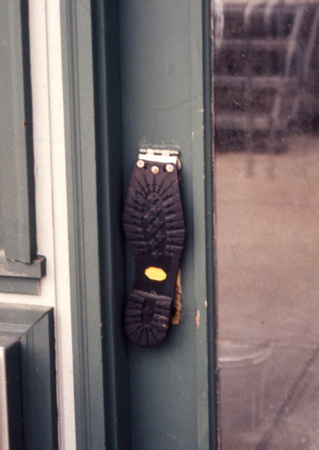 boot sole used as push-plate on shop door