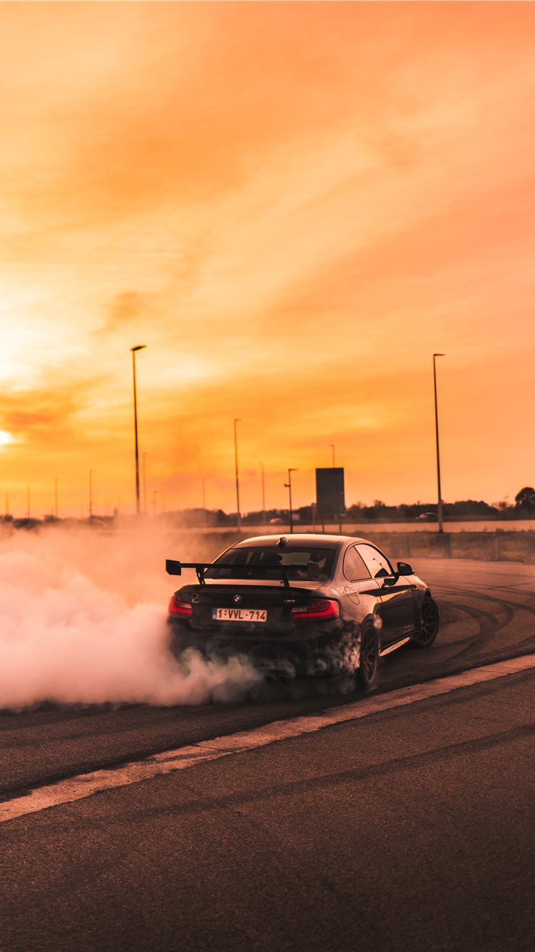 This article explains how to set live wallpapers on an iphone. Black Car Drifting On Road During Day Iphone 8 Wallpapers Free Download