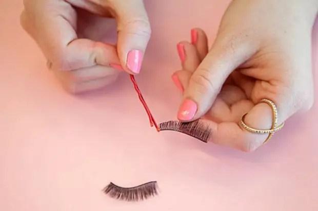 Applying glue to false eyelashes